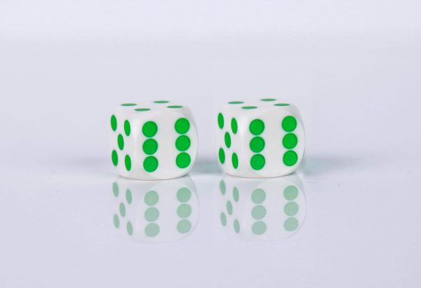 Precision dice calibrated Black with white with green dots